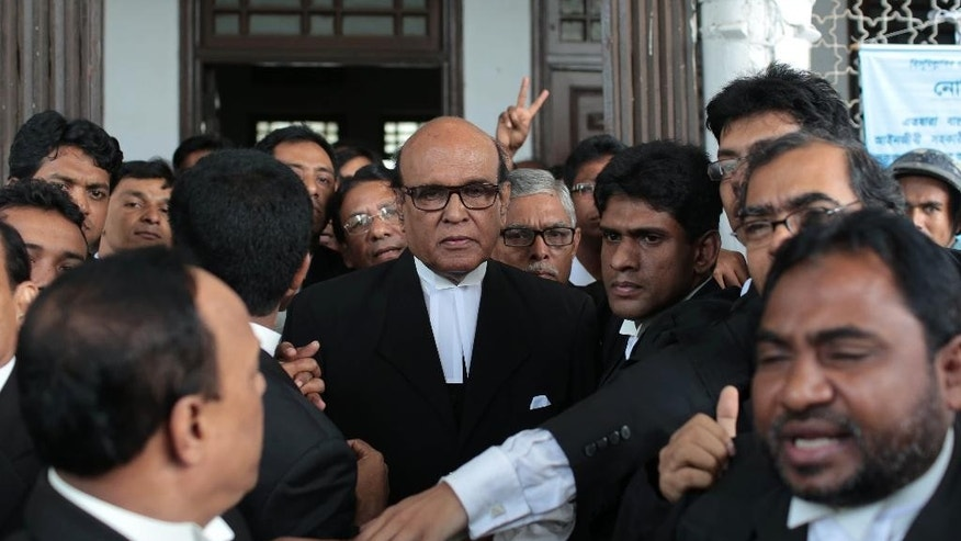 "A Bangladeshi lawyer representing Jamaat-e-Islami leader Delwar Hossain Sayedee leaves the Supreme Court after a ruling commuting the death sentence of the Islamist political leader for war crimes during the nation's 1971 war for independence, in Dhaka, Bangladesh, Wednesday, Sept. 17, 2014. Sayedee must remain in prison ""for the rest of his natural life,"" Chief Justice Muzammel Hossain said. A war crimes tribunal convicted Sayedee in February 2013 for eight counts involving mass killings, rape and atrocities committed during the nine-month war against Pakistan in 1971. (AP Photo/A.M. Ahad)"