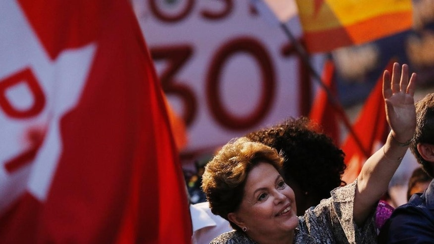 FILE - In this Sept. 12, 2014 file photo, Brazil's President and Workers Party presidential candidate Dilma Rousseff waves to supporters during a campaign rally in Sao Goncalo, metropolitan region of Rio de Janeiro. Under Rousseff and her two-term predecessor Luiz Inacio Lula da Silva, Brazil has given strong backing to leftist regional allies, such as Cuba, Venezuela, Ecuador and Bolivia. (AP Photo/Leo Correa, File)