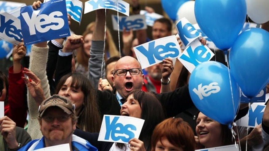 Sept. 17, 2014: People react during a pro Scottish independence campaign rally, in central Glasgow, Scotland.