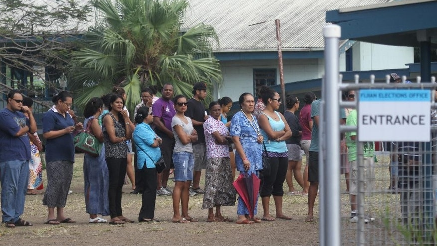 In this photo released by China's Xinhua News Agency, Fijian voters line up at a polling station in Suva, Fiji Wednesday, Sept. 17, 2014. Thousands of Fijians got their first chance to vote in eight years Wednesday in an election that promises to finally restore democracy to the South Pacific nation. (AP Photo/Xinhua, Michael Yang) NO SALES