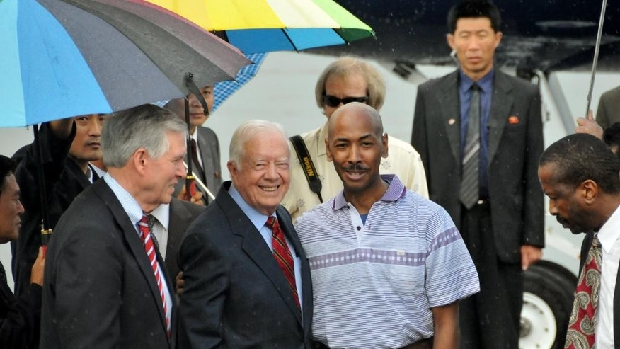 FILE - In this Aug. 27, 2010 file photo released by China's Xinhua news agency, former U.S. President Jimmy Carter, center left, poses with American Aijalon Gomes, center right,  at Pyongyang airport, North Korea. Carter visited North Korea to win the release of the imprisoned American who had been sentenced to eight years of hard labor for crossing illegally into the North from China. Time and again, Americans over the years have slipped into poor, deeply suspicious, fervently anti-American North Korea, crossing a border that tens of thousands of desperate North Koreans have crossed in the opposite direction, at great risk. Whatever their reasons, Americans detained in North Korea, including the three currently there, are major complications for Washington, which must decide between letting a U.S. citizen languish and providing Pyongyang with a huge propaganda victory by sending a senior U.S. envoy to negotiate a release.   (AP Photo/Xinhua, Yao Ximeng, File) NO SALES