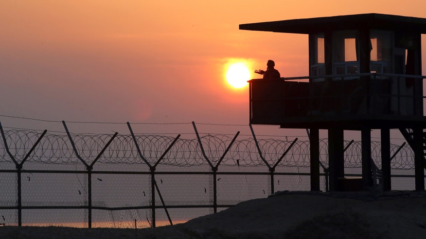 April 2, 2014 - A South Korean soldier guards with his gun at a guard post at sunrise on Baengnyeong Island, South Korea, near the West Sea border with North Korea.