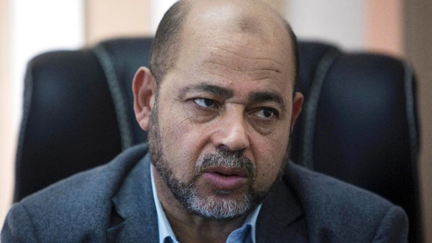 Palestinian Senior Hamas leader Moussa Abu Marzouk, speaks during an interview with The Associated Press in his office in Gaza City, Thursday, Sept. 18, 2014. Hamas' No. 2 leader says the Islamic militant group does not want another war with Israel but suggests more fighting is inevitable unless Israel ends its blockade of Hamas-ruled Gaza. Marzouk said in an interview Thursday that Hamas emerged stronger from the recent 50-day war, despite military setbacks. (AP Photo/Khalil Hamra)
