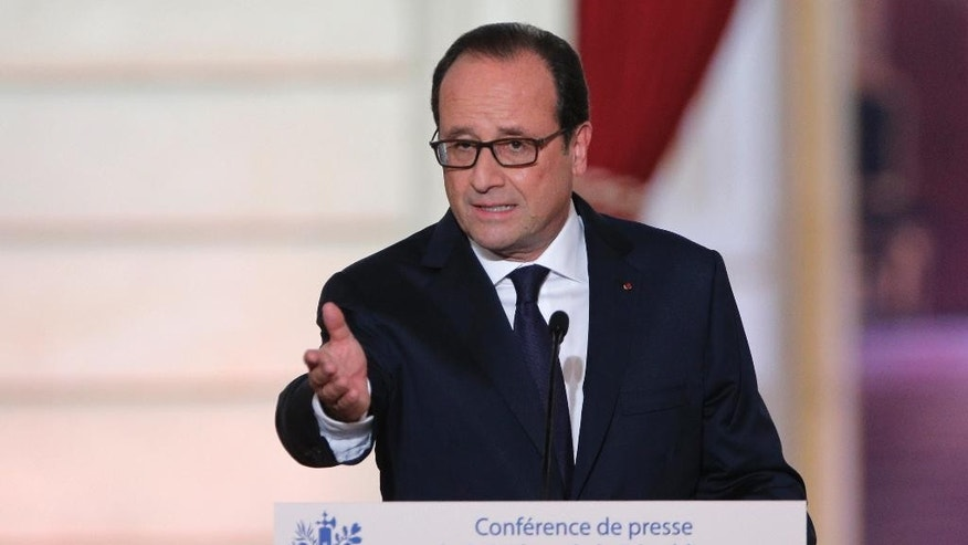 French President Francois Hollande delivers his speech during a press conference at the Elysee Palace, Thursday, Sept.18, 2014. Hollande gives wide-ranging news conference, as he comes under criticism from all sides over his handling of the economy, his government and his private life. (AP Photo/Christophe Ena)
