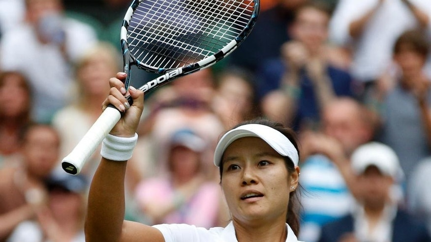 FILE - In this June 23, 2014 file photo, Li Na of China reacts during her first round match against Paula Kania of Poland at the All England Lawn Tennis Championships in Wimbledon, London. Li, a two-time Grand Slam champion from China who took tennis in Asia to a new level, announced her retirement on Friday, Sept. 19, 2014. (AP Photo/Pavel Golovkin, File)
