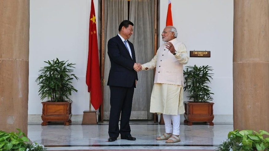 Indian Prime Minister Narendra Modi and visiting Chinese President Xi Jinping shake hands before a meeting in New Delhi, India, Thursday, Sept. 18, 2014. Xi and Modi will hold talks aimed at boosting trade and Chinese investment even as their troops face-off along their disputed border in the Himalayas.  (AP Photo /Manish Swarup)
