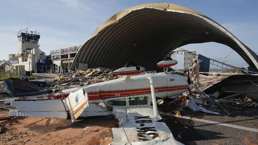 Sept. 17, 2014: A plane destroyed by Hurricane Odile sits overturned at Cabo San Lucas airport Mexico.