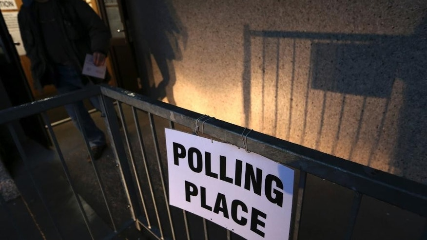 A voter leaves after casting his ballot at Ritchie Hall in Strichen, Scotland, Thursday, Sept. 18, 2014. Polls opened across Scotland in a referendum that will decide whether the country leaves its 307-year-old union with England and becomes an independent state. (AP Photo/Scott Heppell)