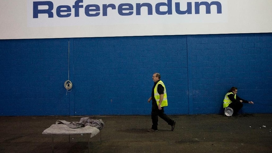 Workers make preparations at the counting centre where the result will be announced in the Scottish independence referendum at the Royal Highland Centre, in Ingliston on the outskirts of Edinburgh, Scotland, Wednesday, Sept. 17, 2014.  Will the ayes have it, or will Scotland say naw thanks? No one is certain. Excitement and anxiety mounted across the country Wednesday, the final day of campaigning before Thursday's referendum on independence. With opinion polls suggesting the result is too close to call and turnout expected to reach record levels, supporters of separation feel they are within touching distance of victory — but wonder whether their surge in the polls will be enough.  (AP Photo/Matt Dunham)
