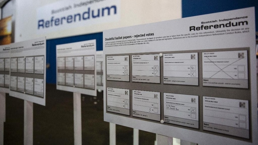 Boards display suggested examples of rejected vote ballot papers at the counting centre where the result will be announced in the Scottish independence referendum at the Royal Highland Centre, in Ingliston on the outskirts of Edinburgh, Scotland, Wednesday, Sept. 17, 2014.  Will the ayes have it, or will Scotland say naw thanks? No one is certain. Excitement and anxiety mounted across the country Wednesday, the final day of campaigning before Thursday's referendum on independence. With opinion polls suggesting the result is too close to call and turnout expected to reach record levels, supporters of separation feel they are within touching distance of victory — but wonder whether their surge in the polls will be enough.  (AP Photo/Matt Dunham)