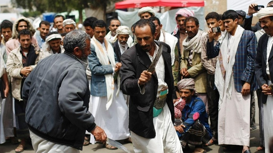 Hawthi Shiite rebels chant slogans during a demonstration demanding the government to step down in Sanaa, Yemen, Friday, Sept. 19, 2014. Shiite rebels and Sunni militiamen battled in the streets of the Yemeni capital for a second day Friday in fighting that has killed at least 120 people, driven thousands from their homes and virtually shut down the country's main airport. The battles are raising fears of greater sectarian conflict, unseen for decades in Yemen. (AP Photo/Hani Mohammed)
