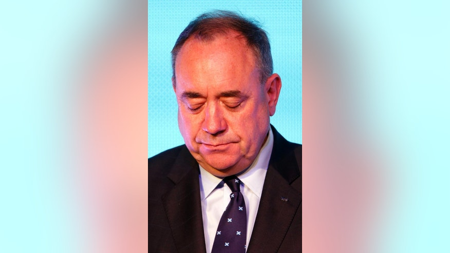 Scottish First Minister Alex Salmond looks down during a press conference in Edinburgh, Scotland, Friday, Sept. 19, 2014. Scottish voters have rejected independence and decided that Scotland will remain part of the United Kingdom. The result announced early Friday was the one favored by Britain's political leaders, who had campaigned hard in recent weeks to convince Scottish voters to stay. It dashed many Scots' hopes of breaking free and building their own nation. (AP Photo/PA, Danny Lawson) UNITED KINGDOM OUT, NO SALES, NO ARCHIVE