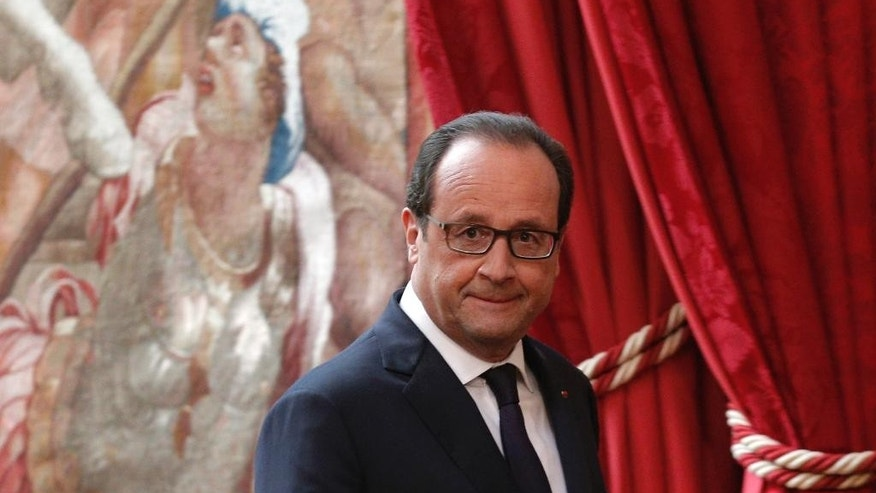 French President Francois Hollande arrives for a press conference at the Elysee Palace, in Paris, Friday, Sept. 19, 2014. Joining U.S. forces acting in Iraqi skies, France conducted its first airstrikes Friday against the militant Islamic State group, destroying a logistics depot that it controlled, Iraqi and French officials said. (AP Photo/Christophe Ena)
