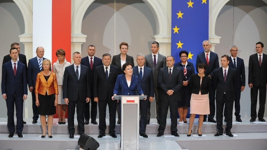 Poland's Prime Minister-designate Ewa Kopacz, center front,  speaks in front of her cabinet during the presentation of ministers in Warsaw, Poland, Friday, Sept. 19, 2014. The new Polish government will be sworn in on Monday Sept. 22. (AP Photo/Alik Keplicz)