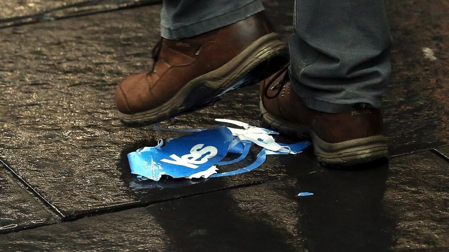 Discarded Yes campaign advertising material is littered on the Royal Mile in Edinburgh, Scotland, Friday, Sept. 19, 2014. Scottish voters have rejected independence and decided that Scotland will remain part of the United Kingdom. The result announced early Friday was the one favored by Britain's political leaders, who had campaigned hard in recent weeks to convince Scottish voters to stay. It dashed many Scots' hopes of breaking free and building their own nation. (AP Photo/Scott Heppell)