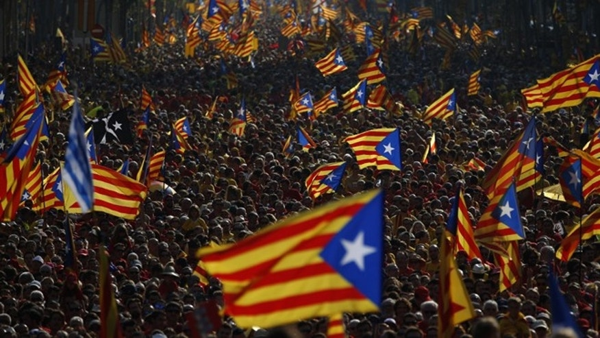 Sept. 11, 2014: Hundreds of thousands of demonstrators stand on the streets waving their estelada flags that symbolizes Catalonia's independence during a protest calling for the independence of Catalonia in Barcelona, Spain.