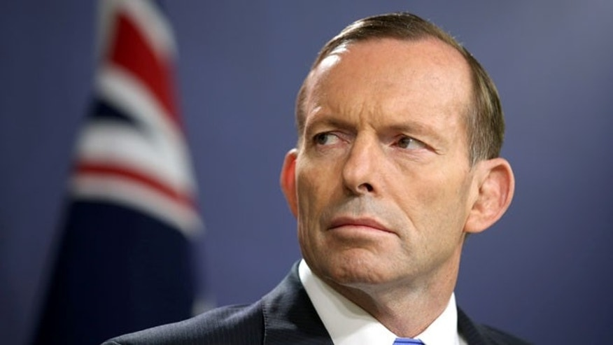 Sept. 19, 2014: Australian Prime Minister Tony Abbott briefs media, in Sydney, Friday, Sept. 19, 2014, after police said they thwarted a plot to carry out beheadings in Australia by Islamic State group supporters when they raided more than a dozen properties across Sydney. (AP)