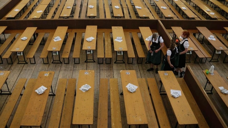 Waitresses await the opening of the 181th Oktoberfest beer festival in Munich, southern Germany, Saturday, Sept. 20, 2014. The world's largest beer festival is held from Sept. 20 to Oct. 5, 2014. (AP Photo/Matthias Schrader)