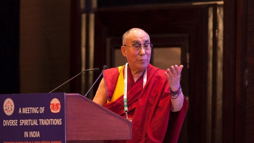 Tibetan spiritual leader the Dalai Lama speaks during an inter-faith meeting in New Delhi, India, Saturday, Sept. 20, 2014. The Dalai Lama brought religious leaders together Saturday to mull some of India's most pressing problems, from gender violence to widespread poverty, while praising the country's religious harmony as proof to the world that different communities can live peacefully together. (AP Photo/Tsering Topgyal)