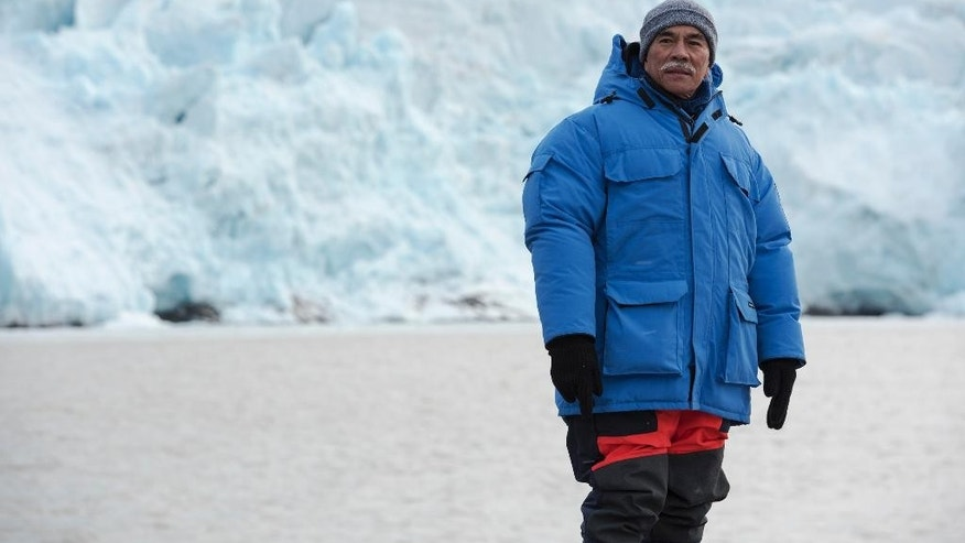 In this photo made available by Greenpeace International, President Anote Tong of the Pacific Island nation Kiribati stands during a retreat to the high Arctic glacier Nordenskioldbreen, on Svalbard, in Norway. Fearing that his Pacific island nation could be swallowed by a rising ocean, the president of Kiribati says a visit to the melting Arctic has helped him appreciate the scale of the threat. President Anote Tong on Saturday, Sept. 20, 2014 ended a Greenpeace-organized tour of glaciers in Norway's Svalbard Archipelago, a trip he said left a deep impression that he would share with world leaders at a U.N. climate summit next week in New York. (AP Photo/Greenpeace International, Christian Aslund)