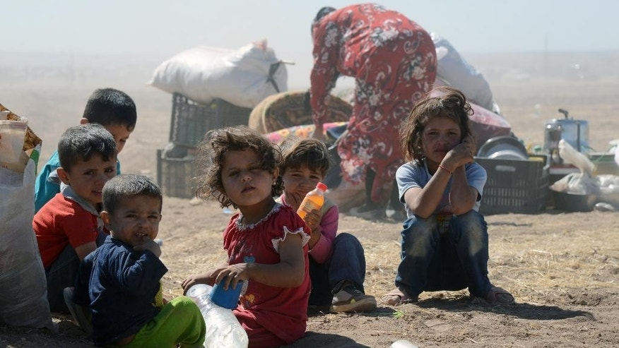 Syrian refugee children at the border in Suruc, Turkey, Saturday, Sept. 20, 2014. Several thousand Syrians, most of them Kurds, crossed into Turkey on Friday to find refuge from Islamic State militants who have barreled through dozens of Kurdish villages in northern Syria in the past 48 hours. (AP Photo)