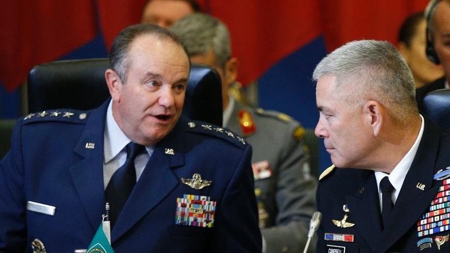 NATO's Supreme Allied Commander, Europe or SACEUR,  U.S. Gen. Philip M. Breedlove, left , and U.S. Army Commander for International Security Assistance Forces (ISAF), Gen. John F. Campbell  attend on  NATO Military Committee Conference in Vilnius, Lithuania, Saturday, Sept. 20, 2014.  (AP Photo/Mindaugas Kulbis)