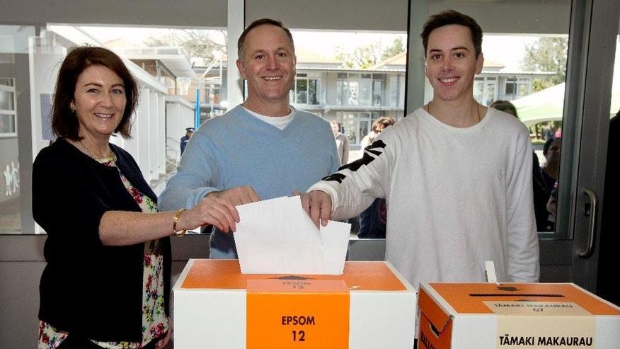 New Zealand Prime Minister and leader of the National Party John Key, center, and his wife Bronagh and son Max cast their votes in the national election in Auckland, New Zealand, Saturday, Sept. 20, 2014. Polls indicate Key's center-right National Party is the most popular party, and Key is the front-runner to remain the country's leader. (AP Photo/New Zealand Herald, Brett Phibbs) NEW ZEALAND OUT, AUSTRALIA OUT