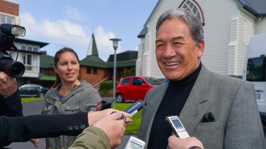 Winston Peters, leader of New Zealand First party, speaks with reporter at a polling station in Auckland, New Zealand, Saturday, Sept. 20, 2014. Voters in New Zealand began casting their ballots Saturday in a general election that has Prime Minister John Key seeking a third term in office. Polls indicate John Key's center-right National Party is the most popular party, and Key is the front-runner to remain the country's leader. (AP Photo/New Zealand Herald, Jason Dorday) NEW ZEALAND OUT, AUSTRALIA OUT