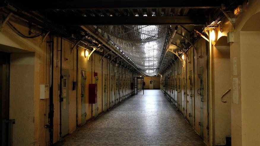View of cells in La Sante prison, in Paris, Sunday, Sept. 21, 2014. Paris' mythic La Santé prison opened its heavily guarded doors to visitors Sunday as part of the country's annual Heritage Days festival. Opened in 1867, the massive brown edifice in Paris' 14th arrondisement has held some of France's most notorious criminals, including international terrorist Carlos The Jackal, Nazi collaborator Maurice Papon, and rogue trader Jerome Kerviel. (AP Photo/Thibault Camus)