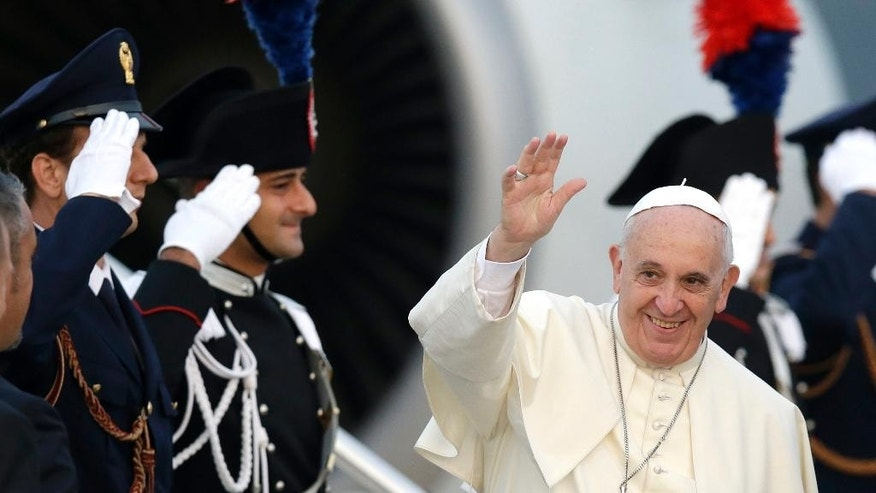 Sept. 21, 2014: Pope Francis waves as he boards a plane on his way to Albania, at Rome's Fiumicino international airport. (AP)