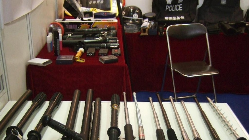 In this undated photo supplied by Amnesty International,  side handled and telescopic batons and spike batons are displayed at a police equipment exhibition, at an undisclosed location. Chinese production and export of police equipment primarily used for torture, such as electric shock wands and neck-and-wrist cuffs connected by a chain, has grown dramatically, enabling human rights violations at home and abroad, Amnesty International said in a report Tuesday, Sept. 23, 2014. (AP Photo/Amnesty International)