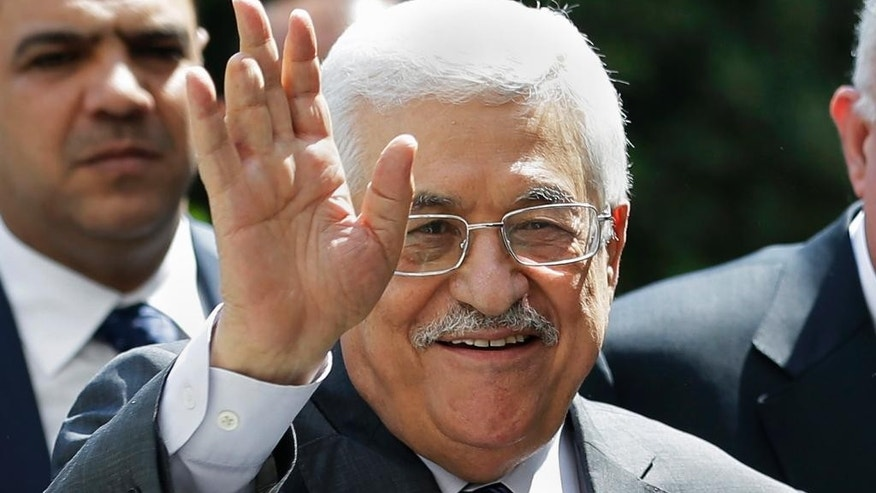FILE - In this Sept. 7, 2014, file photo, Palestinian President Mahmoud Abbas waves to photographers as he arrives to attend an Arab foreign minister meeting at the Arab League headquarters in Cairo, Egypt. It's a busy week in Mideast diplomacy, book-ended by the launch of Israel-Hamas talks about a border deal for blockaded Gaza and the Palestinian president's U.N. speech scheduled for Friday, Sept, 26, 2014, about a new strategy for dealing with Israel. (AP Photo/Hassan Ammar, File)
