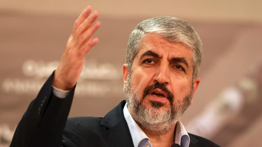 File - In this Aug. 28, 2014, file photo, Khaled Mashaal leader of the Palestinian Islamic militant movement Hamas, that has governed Gaza since a 2007 takeover, speaks during a speech held in Katara in Doha, Qatar. It's a busy week in Mideast diplomacy, book-ended by the launch of Israel-Hamas talks about a border deal for blockaded Gaza and the Palestinian president's U.N. speech scheduled for Friday, Sept, 26, 2014, about a new strategy for dealing with Israel. (AP Photo/Osama Faisal, File)