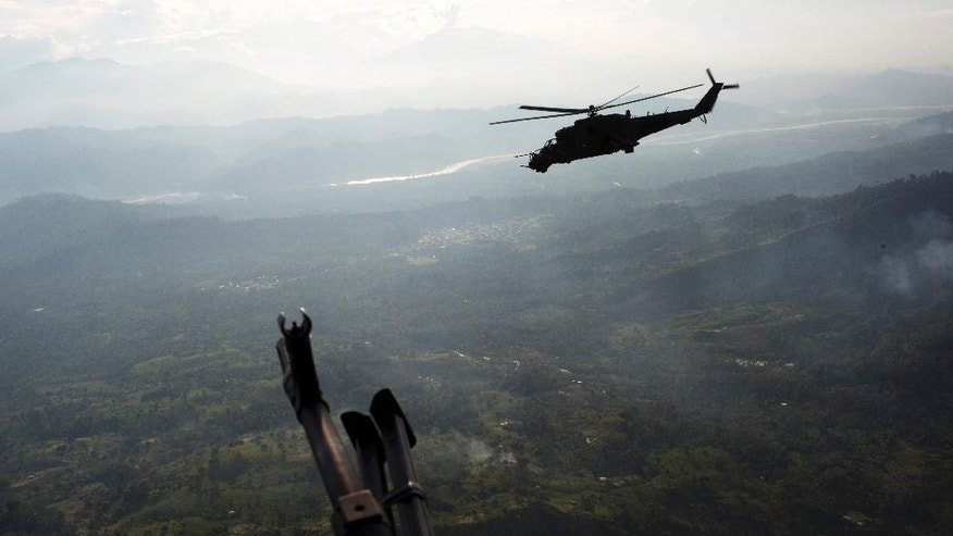 In this Sept. 19, 2014 photo, a military helicopter flies over the VRAEM region, in Pichari, Peru. The region in the Apurimac, Ene and Mantaro River Valleys, or VRAEM, is the world's No. 1 coca-growing region. Security forces destroyed in the last two weeks more than 50 clandestine airstrips used by drug traffickers in the biggest offensive that seeks to combat the intense drug airlift to Bolivia. (AP Photo/Rodrigo Abd)