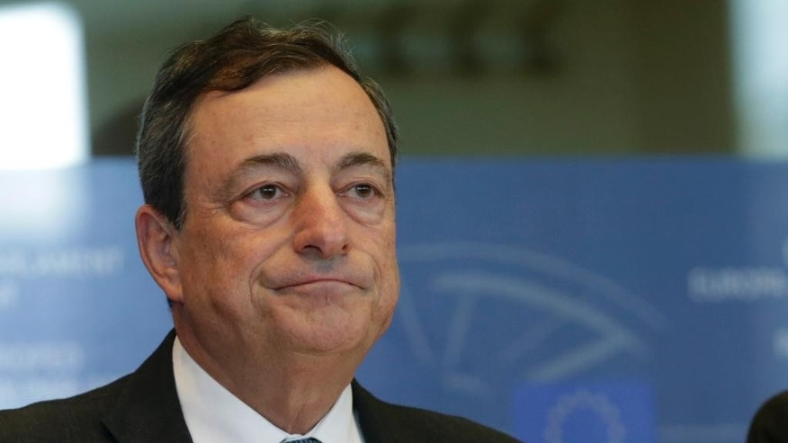 President of the European Central Bank Mario Draghi addresses the Committee on Economic and Monetary Affairs, at the European Parliament building, in Brussels on Monday, Sept. 22, 2014. (AP Photo/Yves Logghe)