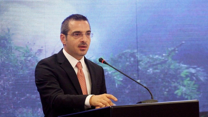 Albania's Interior Minister Saimir Tahiri speaks at a conference in Tirana, Tuesday, Sept. 23, 2014 to show that police have destroyed marijuana of an estimated market value of 6.4 billion euro ($8.2 billion) this year - more than 60 percent of the country's annual GDP. Since March police have destroyed 102 tons of marijuana, 530,000 cannabis plants and have arrested or indicted some 1,900 people. (AP Photo/Hektor Pustina)
