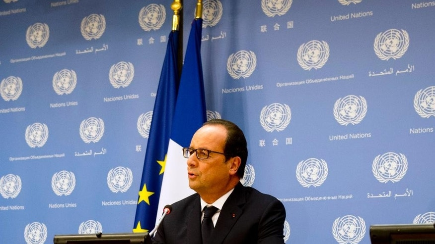 French President Francois Hollande speaks on the sidelines of the 69th United Nations General Assembly Tuesday, Sept. 23, 2014, at the United Nations.  (AP Photo/Alain Jocard, Pool)