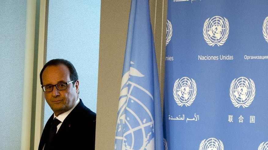 French President Francois Hollande arrives to give a statement on the French hostage situation on the sidelines of the 69th United Nations General Assembly Tuesday, Sept. 23, 2014, at the United Nations.  (AP Photo/Alain Jocard, Pool)