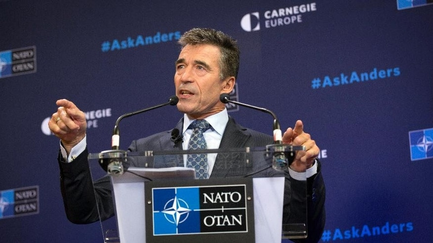 "NATO Secretary General Anders Fogh Rasmussen speaks during a Carnegie Europe think tank event at the Bibliotheque Solvay in Brussels on Monday, Sept. 15, 2014. In a farewell speech as NATO's top civilian official, Rasmussen said the alliance finds itself on the front lines of a geopolitical division between ""tolerance and fanaticism,"" and ""democracy and totalitarianism."" Rasmussen's five-year term as NATO secretary general comes to a close at the end of the month. (AP Photo/Virginia Mayo)"