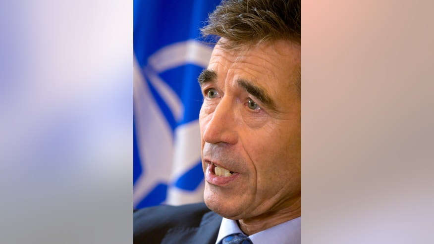 "NATO Secretary General Anders Fogh Rasmussen speaks with the Associated Press during an interview at the Bibliotheque Solvay in Brussels on Monday, Sept. 15, 2014. In a farewell speech as NATO's top civilian official, Rasmussen said the alliance finds itself on the front lines of a geopolitical division between ""tolerance and fanaticism,"" and ""democracy and totalitarianism."" Rasmussen's five-year term as NATO secretary general comes to a close at the end of the month. (AP Photo/Virginia Mayo)"