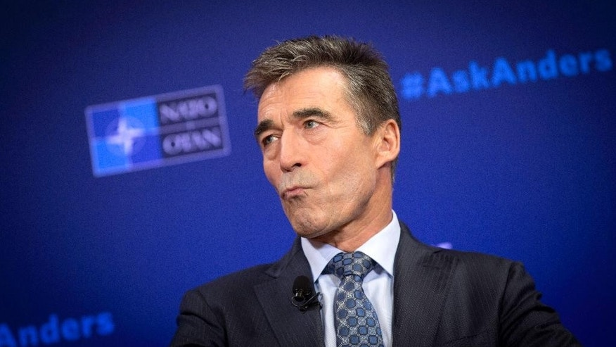 "NATO Secretary General Anders Fogh Rasmussen pauses before speaking during a Carnegie Europe think tank event at the Bibliotheque Solvay in Brussels on Monday, Sept. 15, 2014. In a farewell speech as NATO's top civilian official, Rasmussen said the alliance finds itself on the front lines of a geopolitical division between ""tolerance and fanaticism,"" and ""democracy and totalitarianism."" Rasmussen's five-year term as NATO secretary general comes to a close at the end of the month. (AP Photo/Virginia Mayo)"