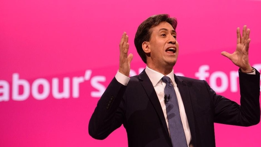 Labour leader Ed Miliband makes his keynote speech to delegates during his party's annual conference at Manchester Central Convention Complex, Manchester, England, Tuesday, Sept. 23, 2014. This is the last Labour party conference before the general election which is scheduled for 2015. (AP Photo/Owen Humphreys, PA Wire)     UNITED KINGDOM OUT  NO SALES  NO ARCHIVES