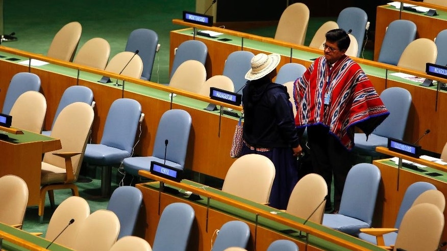 Delegates in traditional attire stand in the General Assembly hall at United Nations headquarters, Monday, Sept. 22, 2014.  The World Conference on Indigenous Peoples began Monday at the U.N. (AP Photo/Jason DeCrow)