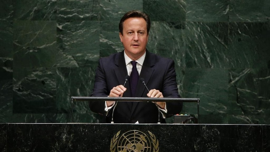 British Prime Minister David Cameron addresses the 69th session of the United Nations General Assembly Wednesday, Sept. 24, 2014, at the United Nations headquarters. (AP Photo/Frank Franklin II)