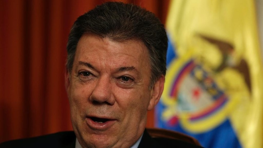 Colombian President Juan Manuel Santos talks to The Associated Press, Tuesday, Sept. 23, 2014, in New York. (AP Photo/Julio Cortez)