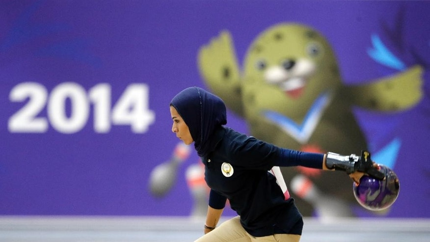Kuwait's Karam Altaf competes in women's singles squad A bowling competition at Anyang Hogye Gymnasium at the 17th Asian Games in Anyang, South Korea, Wednesday, Sept. 24, 2014. (AP Photo/Lee Jin-man)