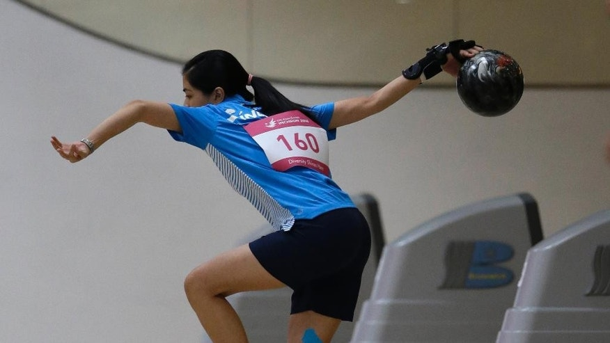 Singapore's Tan Daphne competes in women's singles squad A bowling competition at Anyang Hogye Gymnasium at the 17th Asian Games in Anyang, South Korea, Wednesday, Sept. 24, 2014. (AP Photo/Lee Jin-man)