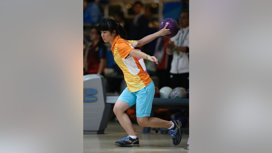 Taiwan's Chou Chia Chen competes in women's singles squad A bowling competition at Anyang Hogye Gymnasium at the 17th Asian Games in Anyang, South Korea, Wednesday, Sept. 24, 2014. (AP Photo/Lee Jin-man)