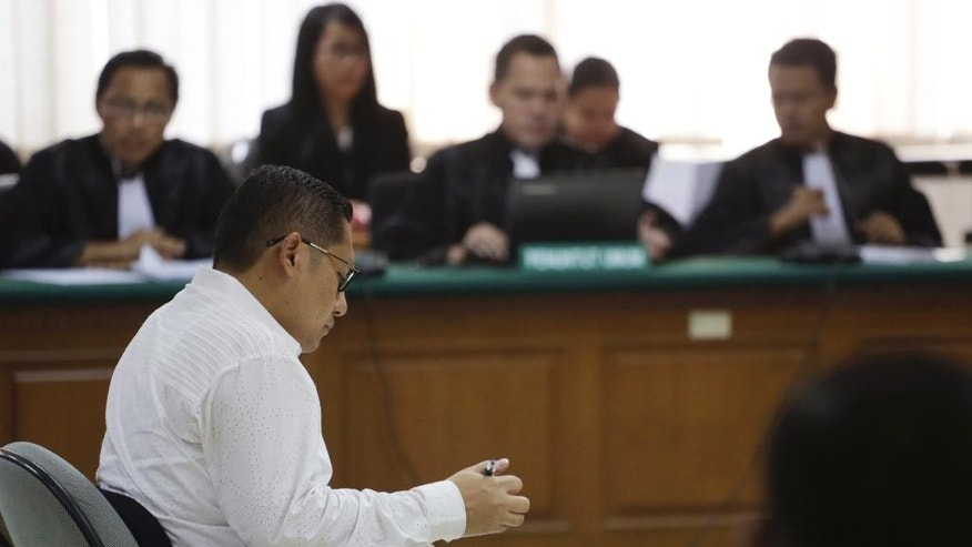 Anas Urbaningrum, former general chairman of President Susilo Bambang Yudhoyono's Democratic Party, sits in the anti-graft court's courtroom during his verdict trial in Jakarta, Indonesia, Wednesday, Sept. 24, 2014. The court has sentenced Urbaningrum to eight years in jail for corruption and money laundering. (AP Photo/Achmad Ibrahim)