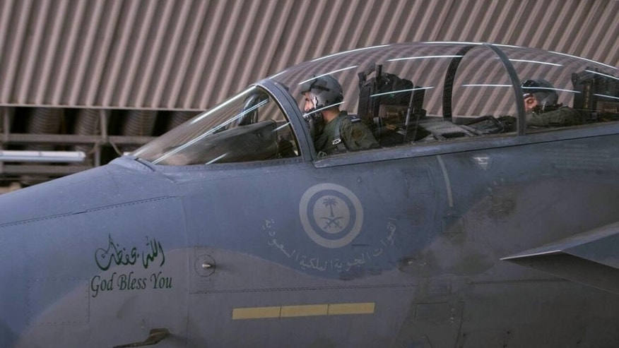 "In this image released Wednesday, Sept. 24, 2014 by the official Saudi Press Agency, Saudi pilots sit in the cockpit of a fighter jet as part of U.S.-led coalition airstrikes on Islamic State militants and other targets in Syria that began early Tuesday. Arab countries' prominent role in initial airstrikes against the Islamic State group in Syria shatters the notion of what a typical American-led military operation looks like and won the Mideast allies' praise from U.S. President Barack Obama for their willingness to stand ""shoulder-to-shoulder"" with the United States. It is a reflection of their growing concern about the threat posed by Islamic extremists, and a chance to flex some military muscle toward regional rival Iran _ a key supporter of governments in both Syria and Iraq. The strategy is not without risks. (AP Photo/Saudi Press Agency)"